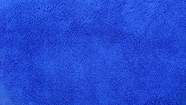 Bидео blue cloth texture background rotate