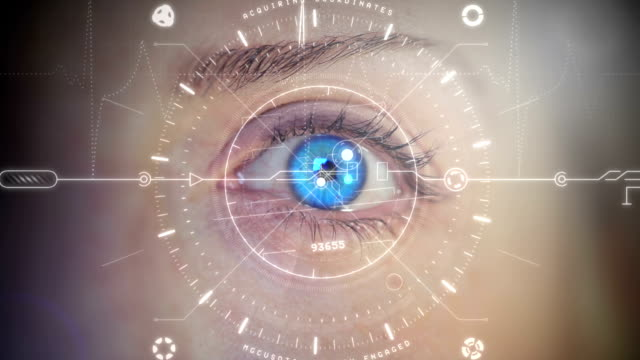 Blue Digital Eye. HD Close up of a beautiful blue eye with head-up display. Technology related concept. cyborg stock videos & royalty-free footage