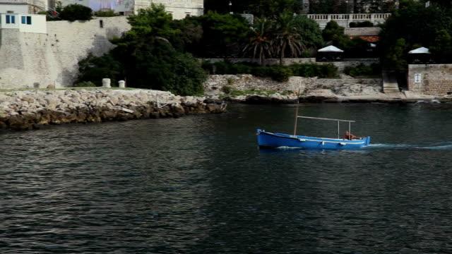 Blue fishing boat in sea video