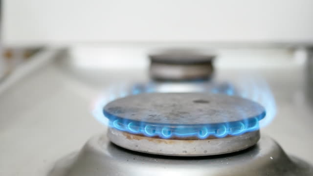 blue flame on a kitchen stove burner