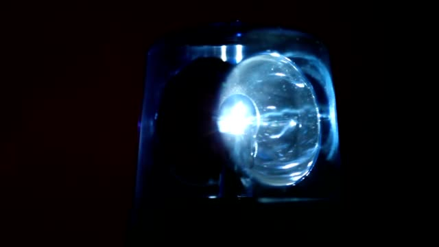 Blue flasher rotates rapidly in dark video