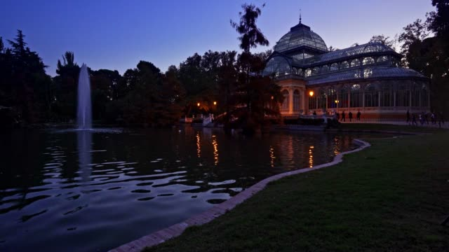 Blue hour view of Crystal Palace or Palacio de cristal in Retiro Park in Madrid, Spain.