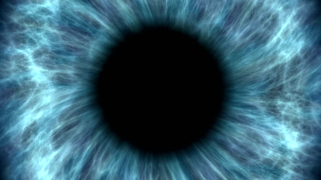 blue human eye dilating and contracting. very detailed extreme close-up of iris and pupil. - vicino video stock e b–roll