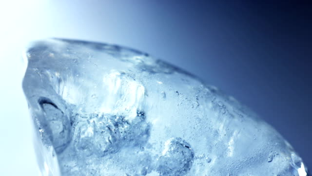 Blue ice thawing close-up timelapse video