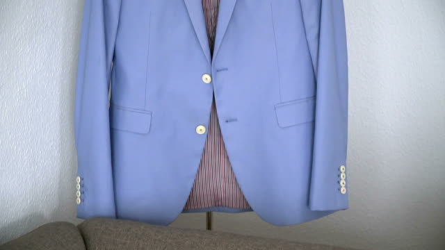 blue jacket hanging on a hanger video