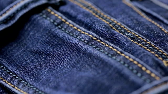 Blue jeans texture. can use as background. close-up of denim video