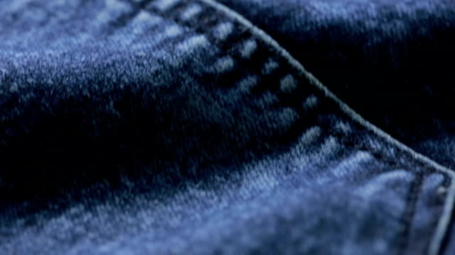 blue jeans texture. can use as background. close-up of denim - jeans video stock e b–roll