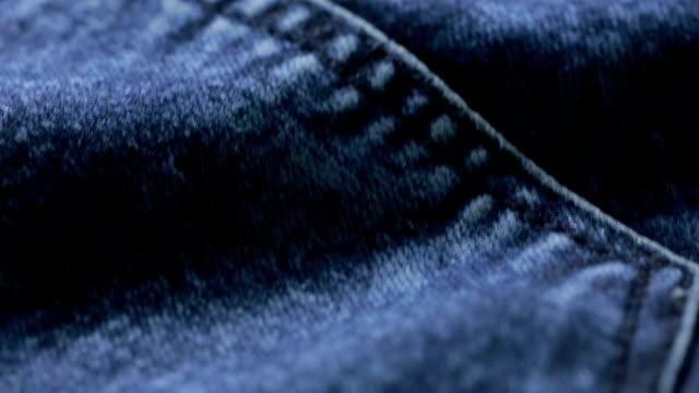 blue jeans texture. can use as background. close-up of denim - dżinsy filmów i materiałów b-roll