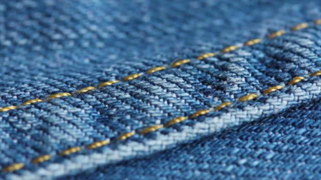 4k blue jeans texture close up - dżinsy filmów i materiałów b-roll