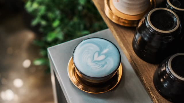 Blue Latte Cinemagraph Cinemagraph : Butterfly pea latte art heart mug stock videos & royalty-free footage