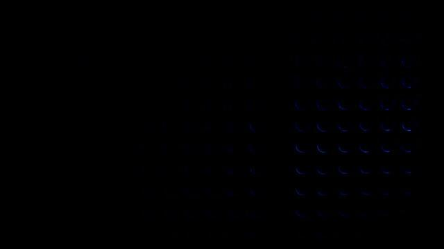 Blue light illuminates round holes on metal grill video