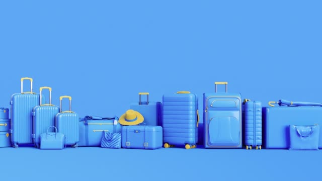 blue luggage and vacation equipment on blue pastel background. - kompozycja flat lay filmów i materiałów b-roll