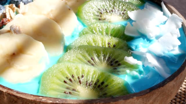 blue majik, spirulina superfood smoothie coconut bowl rotating video