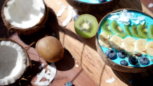 blue majik, spirulina superfood smoothie coconut bowls dolly flatlay, above video
