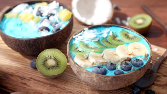 blue majik, spirulina superfood smoothie coconut bowls in windy shade video