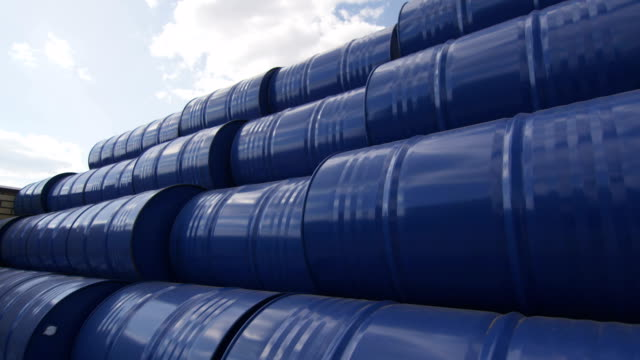 blue metal tanks for oil products on plant yard - brent video stock e b–roll