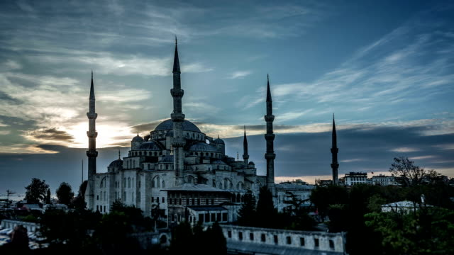 Blue Mosque in Istanbul at Sunset. HD Time Lapse The Sultan Ahmed Mosque (Turkish: Sultan Ahmet Camii) is a historic mosque in Istanbul. The mosque is popularly known as the Blue Mosque. Aerial view at sunset. HD Time Lapse. istanbul stock videos & royalty-free footage