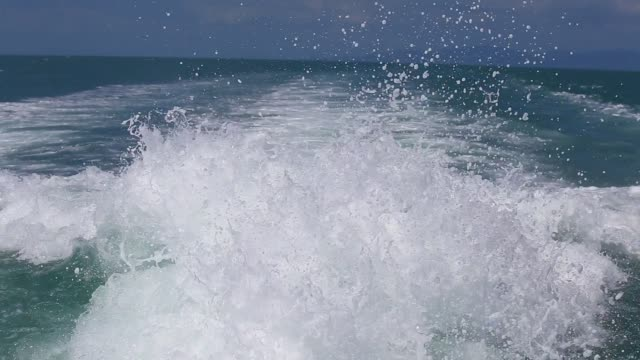 Blue ocean sea water wave with fast yacht boat wake foam of prop wash, Thailand Blue ocean sea water wave with fast yacht boat wake foam of prop wash. Close up, Thailand prop stock videos & royalty-free footage
