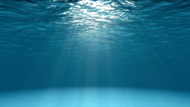 Blue ocean surface seen from underwater video