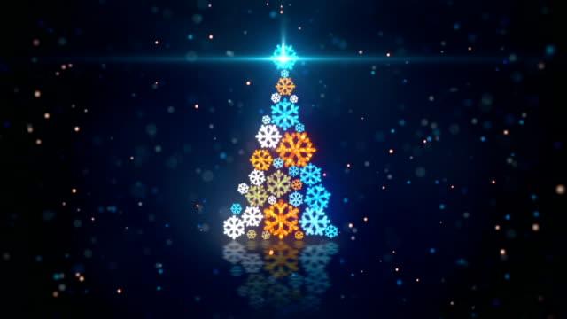 blue orange christmas tree shape of glowing snowflakes loop video