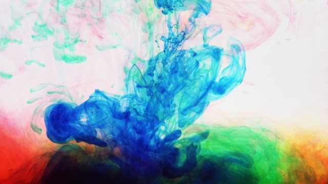 blue paint is poured into a multicolored mix. ink paint in water, relax background