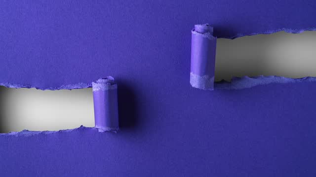 Blue paper is torn over white background for message, stop motion, animation. Template for your text.