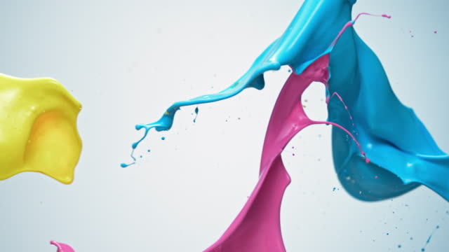 SLO MO Blue, pink and yellow paint colliding in the air