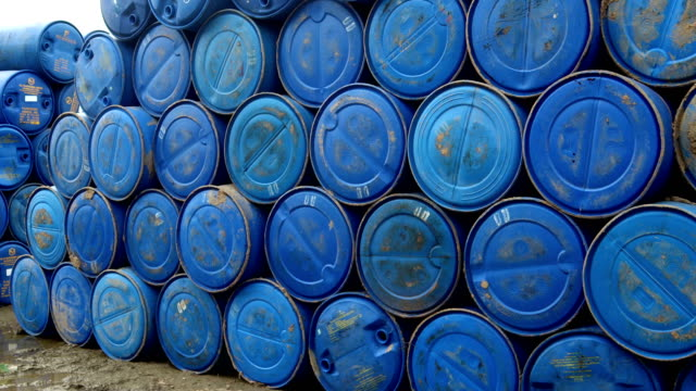 Blue Plastic Barrel 4K Full HD : - Large group of blue barrels in warehouse. The standard barrel of crude oil or other petroleum product. Plastic drums are manufactured through a process called blow molding. This process allows for various shapes to be created with no seams on the inside. Barrels are still molded in a cylindrical shape to allow for rolling and handling using the same tools as a steel drum. oil industry stock videos & royalty-free footage