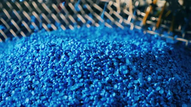 Blue plastic granules raining down video