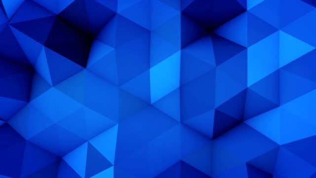 Blue polygonal geometric surface vibrating seamless loop video