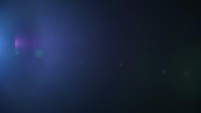 blue real lens flare background, alpha channel. - flara obiektywu filmów i materiałów b-roll