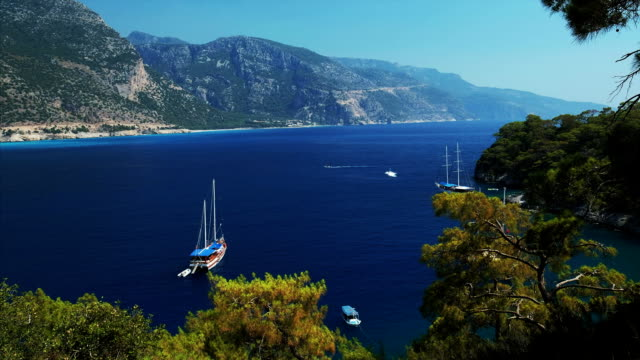 blue sea and sail boats - fethiye video stock e b–roll