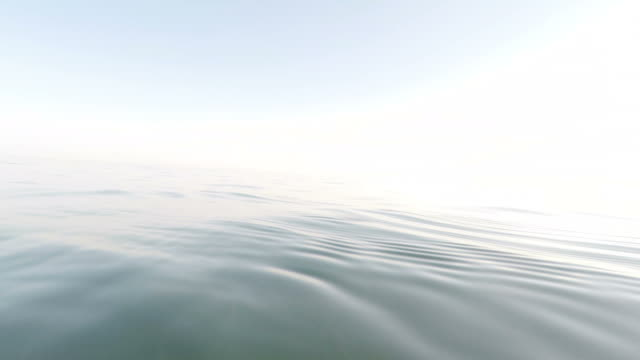 blue sea at sunset with camera floating and submerged in the water - sky diving video stock e b–roll