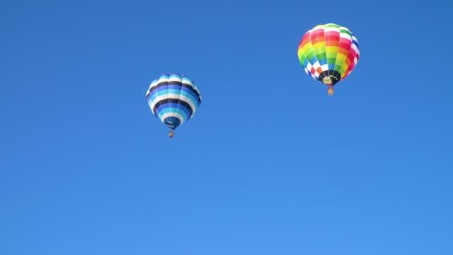 Blue sky and a balloon Blue sky and a balloon hot air balloon stock videos & royalty-free footage