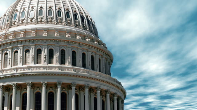 A blue sky time lapse over the dome of the United States Capitol building in Washington D.C. USA