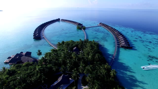 Blue sky, turquoise sea, white sand and green palm trees in Maldives - Ayada Island