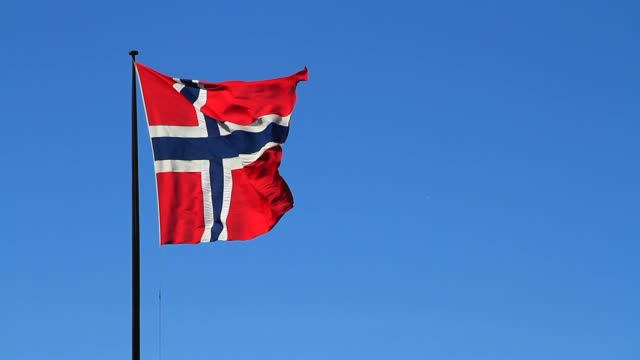 Blue sky with Norwegian flag video