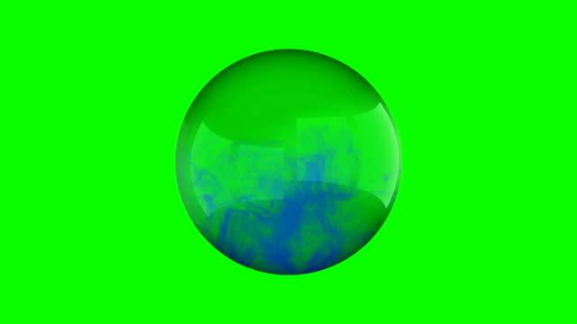 Blue smoke fills a glass sphere