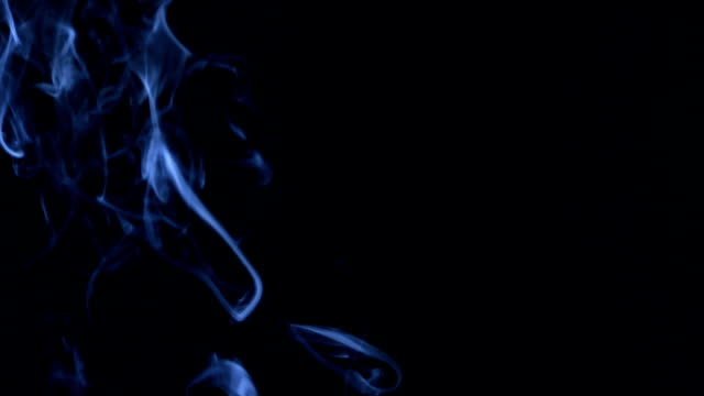 Blue smoke in the form of rings on a black background video