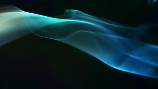 Blue smoke on black background video