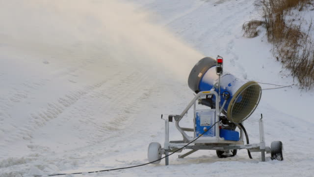 A blue snow blower on the resort video