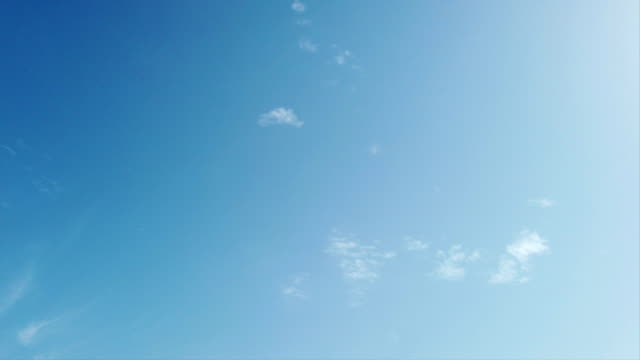 Blue summer sky in time lapse with soft movement and withe cirrus clouds