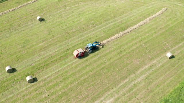 Blue Tractor Hay Bales Aerial View