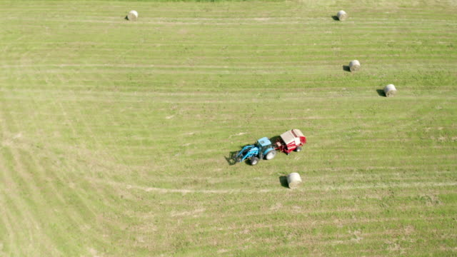 Blue Tractor Hay Bales Field Aerial View
