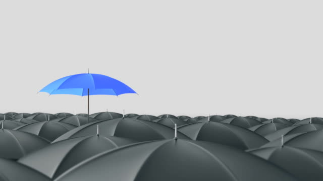 Blue umbrella standing out from crowd mass concept