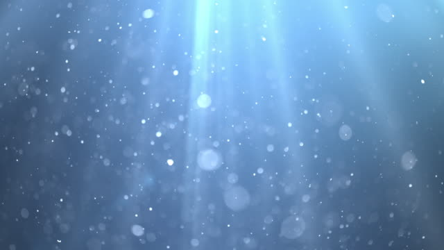 Blue Underwater with Sun Rays. 4K Background of sun rays piercing through a blue sea with floating particles. undersea stock videos & royalty-free footage