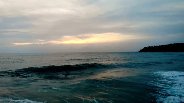 blue water beach sunset with drone shot - mar mediterraneo video stock e b–roll