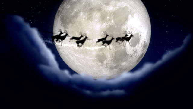 vídeos de stock e filmes b-roll de blue xmas night with moon and clouds with santa claus sleight and reindeer silhouette enter and exit flying with text space to place logo or copy.animated christmas present greeting post card 4k video - pai natal