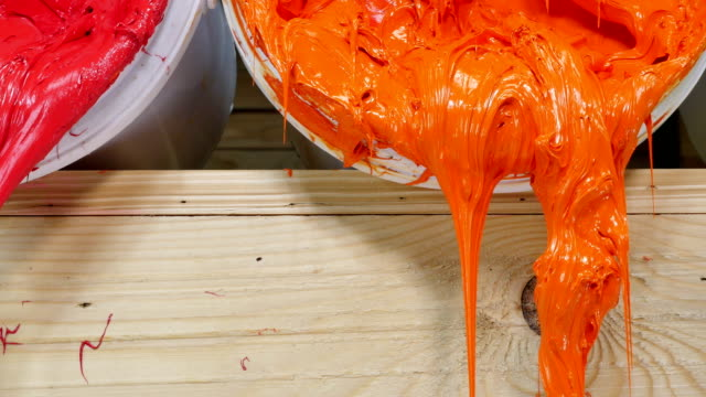 blue yellow orange and red colors of ink for print tee shirt flowed out of barrel video