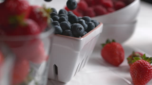 Blueberries falling into bowl video